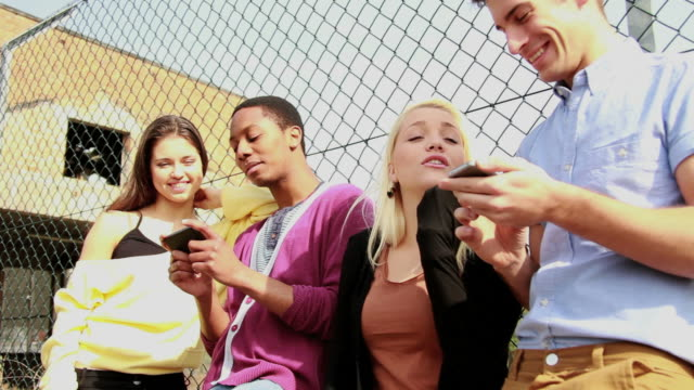 Group of teenagers with mobile phones video