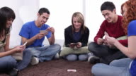 Group of teens playing cards together video