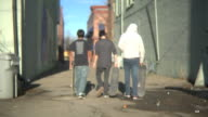 Group of teens walking down an alley video