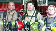 Group of three multi-ethnic firefighters at the station video