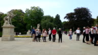 Group of tourists taking pictures on square in historic part video