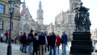 Group of tourists tour European architecture attraction site day. Beautiful shot of Europe, culture and landscapes. Traveling sightseeing, tourist views landmarks of Germany. World travel, west European trip cityscape, outdoor shot video