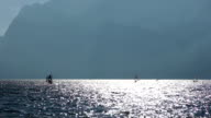 Group of windsurfers on strong wind and waves, Italy video