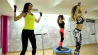 Group of women in the gym jumping on a mini trampoline video