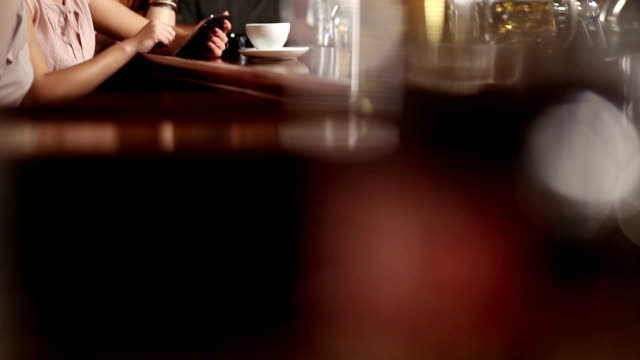 Group of women with tablet in Pub video