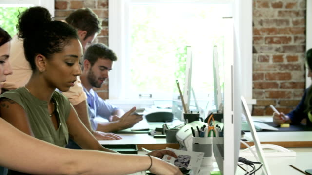 Group Of Workers At Desks In Busy Design Office video
