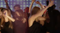 Group of young adults dancing together video