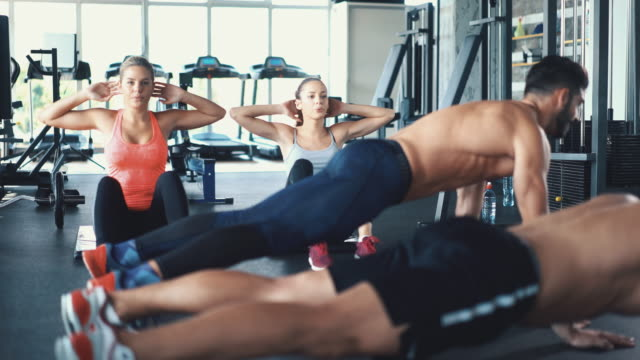 Group of young adults exercising in a gym video