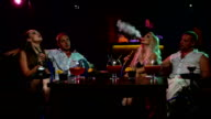 Group of young and sexy people smoking hookah video