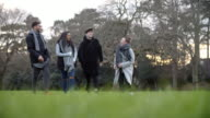 Group Of Young Friends Walking Through Park In Winter video