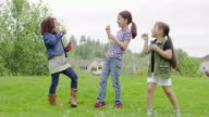 Group of young girls blowing bubbles together outside video