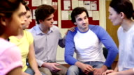 Group Of Young People Having A Discussion video