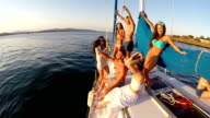 Group of young people having fun on yacht video