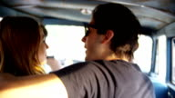 Group of young people on road trip video