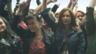 Group of young teenagers at a music festival video