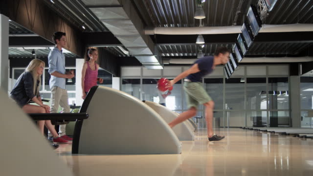 Group playing Bowling video