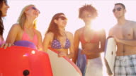 Group Teenage Vacation Friends Carrying Body Boards Beach video