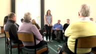 Group Therapy Support - Young woman shares with other people video