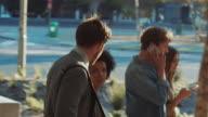 Group walking on street video