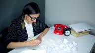 Grumpy nerdy woman in her retro office video