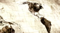 grunge stained map of the world loopable video