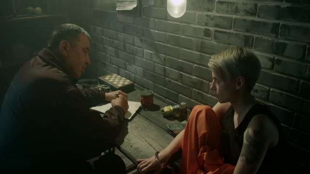 Guard interrogating women in jail video