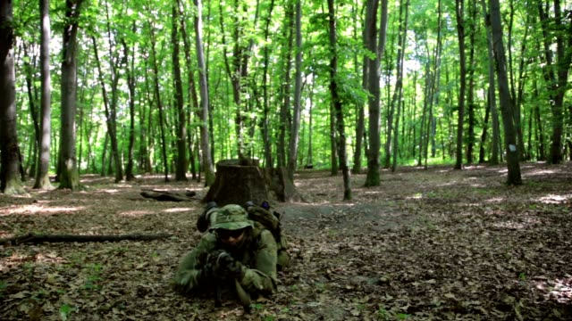 Guerilla partisan warriors attacking aiming in forest ambush carrying their guns video