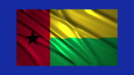 Guinea Bissau flag waving,loopable on blue screen video