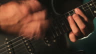 Guitar performance with light effects, Closeup video