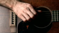 Guitar player's hand touching strings. Music performance. FullHD video video