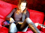 Guitar Playing Woman Sitting and Strumming video