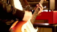 Guitarist. Close-up on a male hand playing hard on a electric guitar. Defocus. video