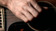 Guitarist hand and guitar strings. Music performance. FullHD close-up video video