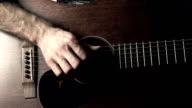 Guitarist hand touching guitar strings. Music performance. FullHD video video
