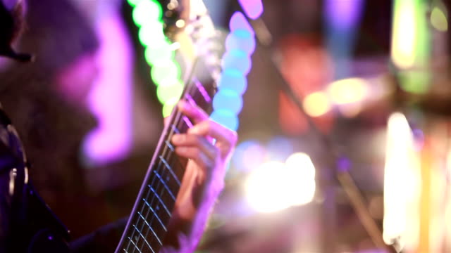 Guitarist perform for fans at a rock concert. video