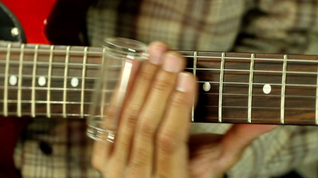 guitarist play blue music with bottle slide video