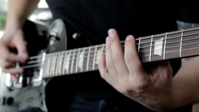 Guitarist play on black electric guitar video