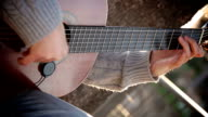 guitarist playing acoustic guitar in the street: street artist video