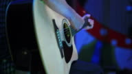 Guitarist Playing Acoustic Guitar on Stage video