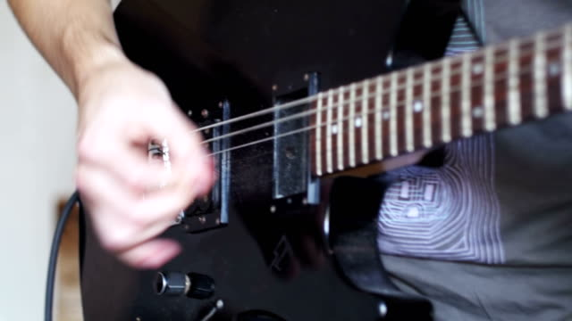 Guitarist Playing An Electric Guitar At Home Studio video