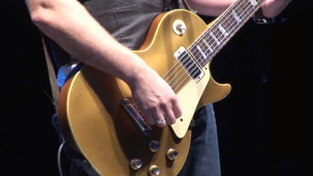 Guitarist plays Electric guitar at live concert / gig video