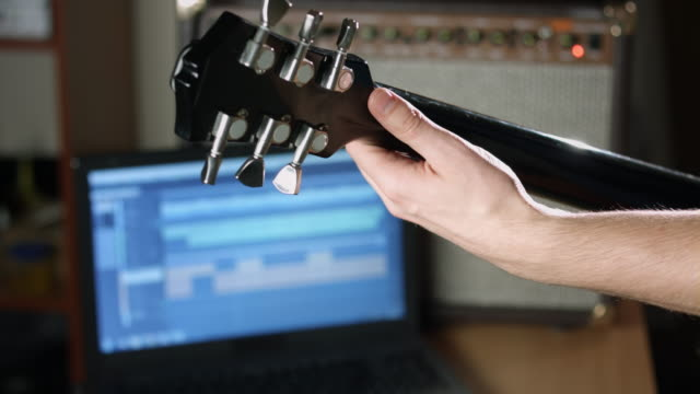 Guitarist record guitar session video