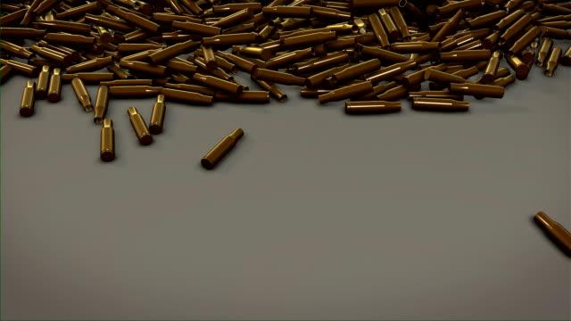 Gun bullet shells, empty ammos on the floor video