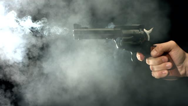 Gun shooting, slow motion video
