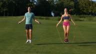 Guy and  girl are jumping on the jump rope. video