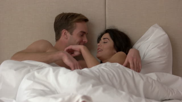 Guy and girl in bed. video