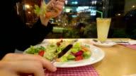 Guy enjoying appetizing salad, eating out, having low-fat dinner video