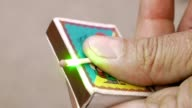 Guy is lighting matchstick with a green laser beam video