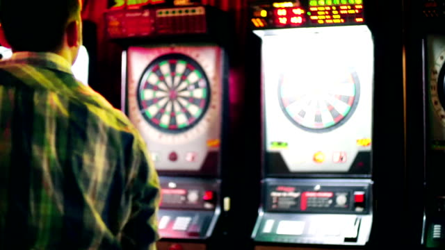Guy playing darts. video