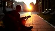 Guy playing guitar video